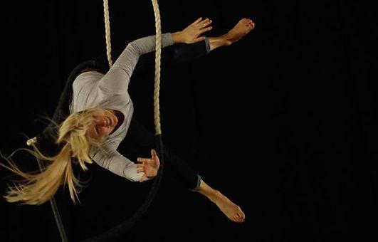sedona rose, sedona ferguson, circus performer london, actor trapeze, trapeze artist london, circus performer, london actor circus performer, pink trapeze, dance trapeze artist