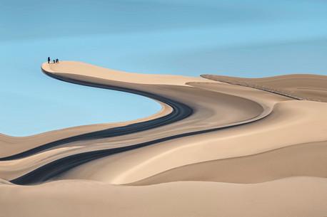 Climbing the dunes.JPG