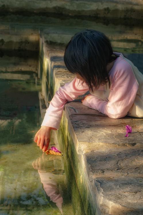 Young girl at pond at the Calgary Zoo, Alberta