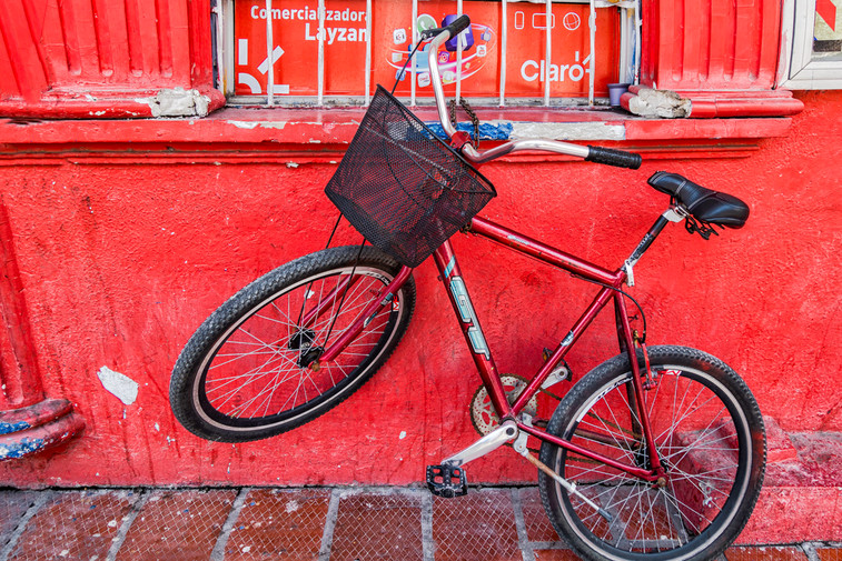 A bike in front of a red wall