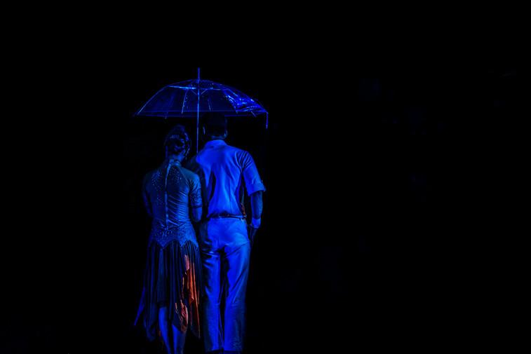 Dancers dressed in blue