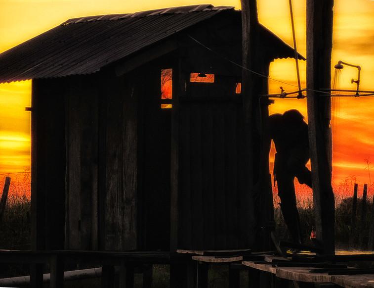 Having an outdoor shower at sunset