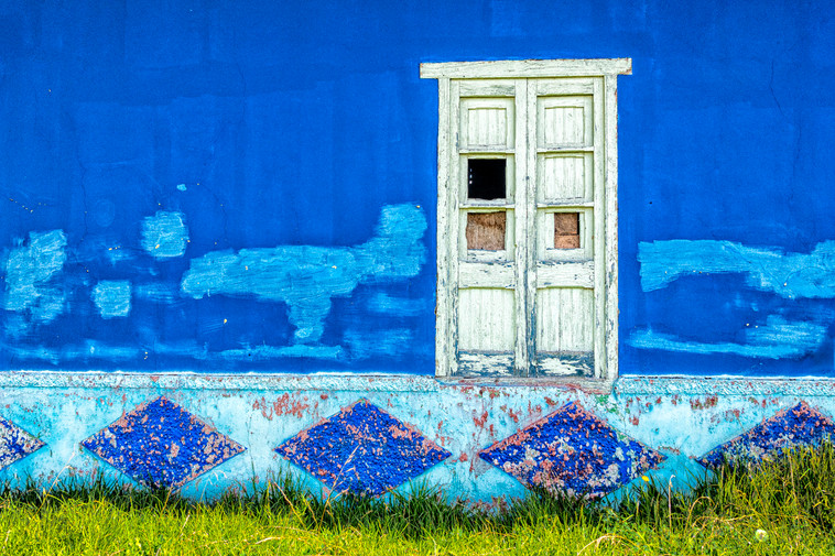 White door in a blue wall