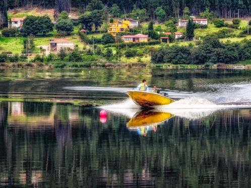 Speed boat reflection