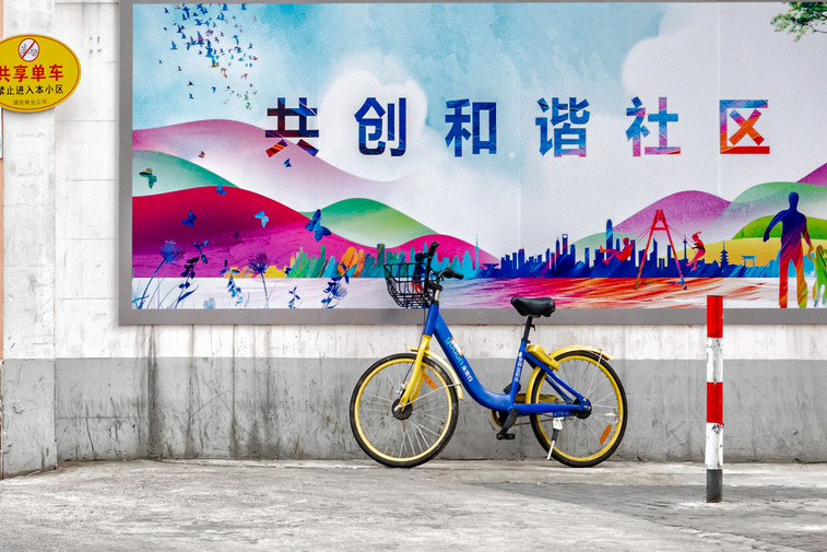 Bicycle in front of colourful wall in China