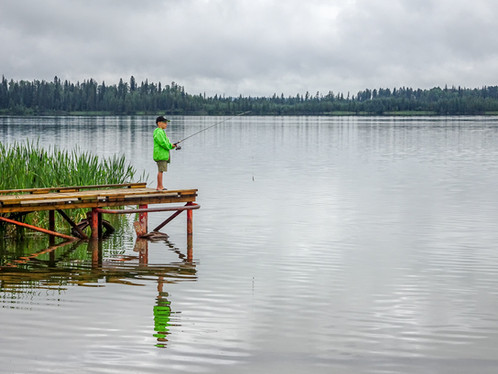 Fishing at Crimson Lakes Park, Alberta, Canada