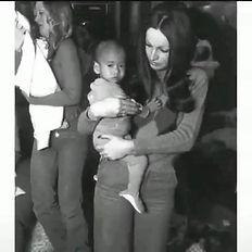 Playboy bunny holding baby.jpg