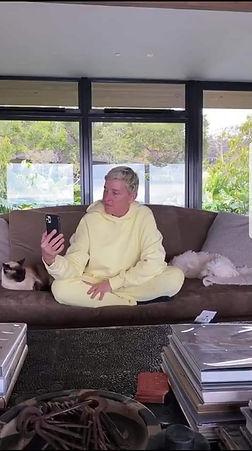 Ellen on couch in sweats with keys ash t