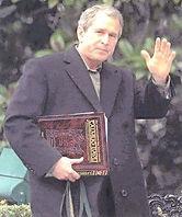gw bush with bidns satanic bible.jpg