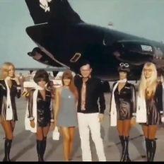 Playboy HH bunnies and plane.jpg