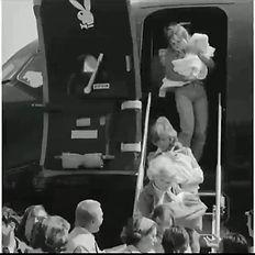 Playboy bunny baby leaving jet.jpg