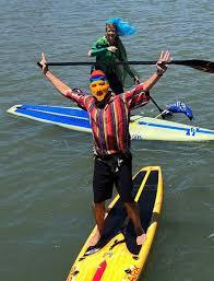 John on a paddleboard.png