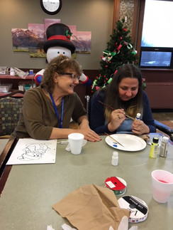 Painting a Christmas tree ornament.