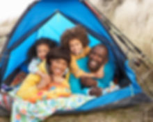 Young Family Relaxing Inside Tent On Cam