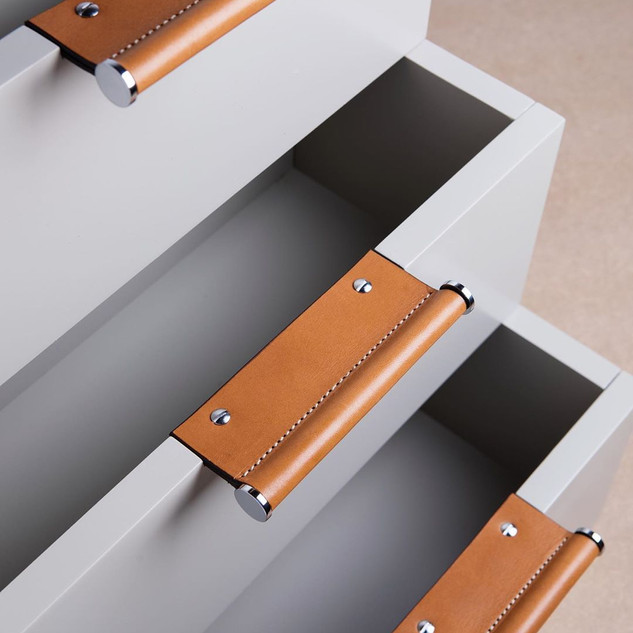 Tan leather and bright chrome wing edge handles