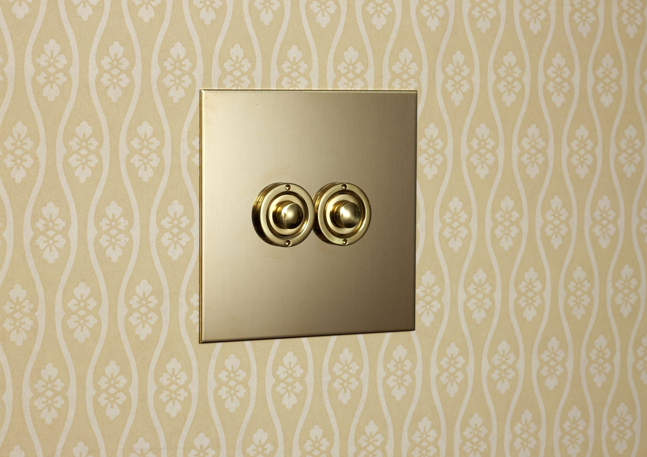 Unlacquered brass momentary button