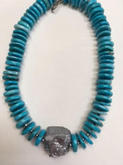 Turquoise magnesite and silver plated quartz necklace | $90
