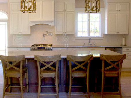 White Raised Panel Cabinets in Kitchen