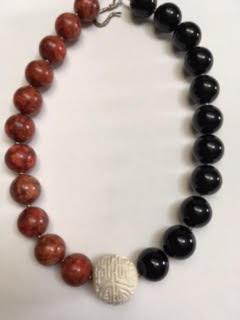 Black onyx, red sponge coral, white cinnabar necklace   $95