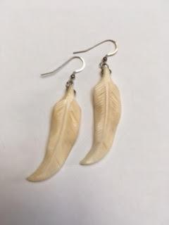 Vintage bone feather shaped earrings   $30