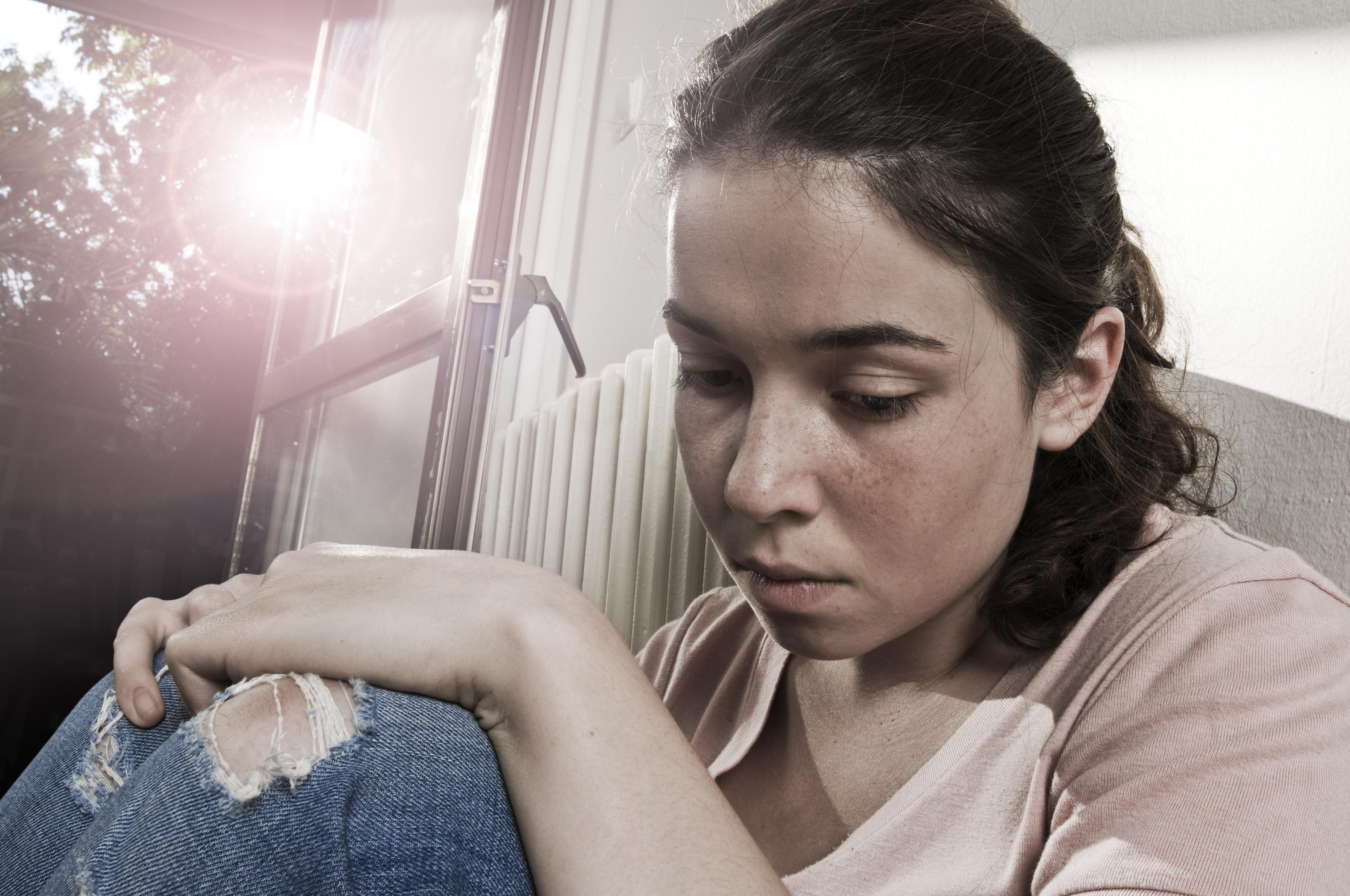 Sad pensive girl_iStock_10080491_XLARGE