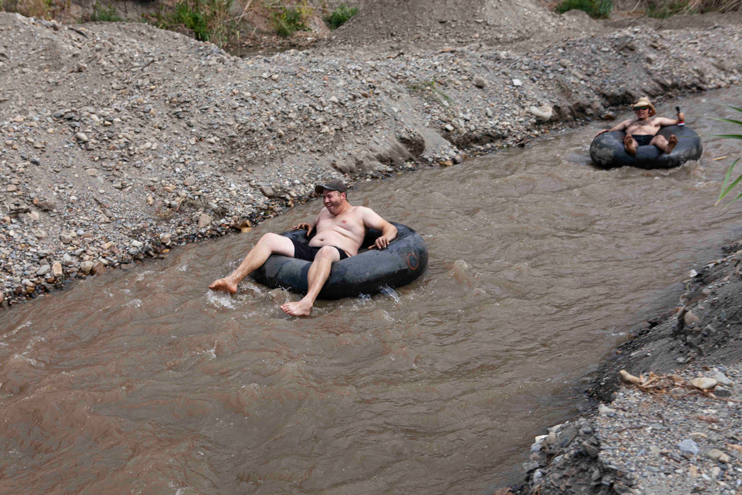 Daniel and Vegard rafting down a river on old car tires.