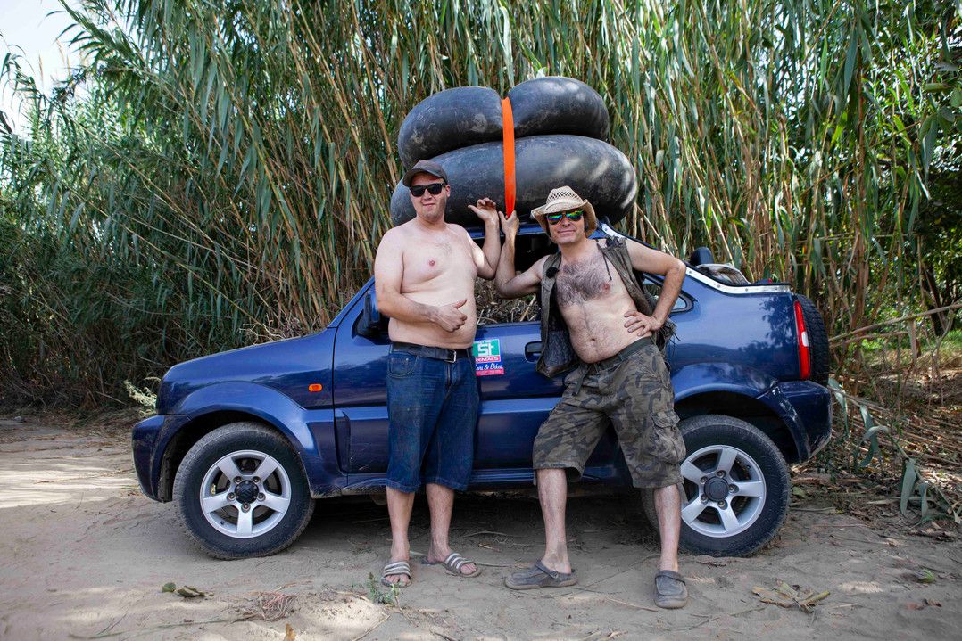 Erik and Vegard get ready for rafting on old car tires.