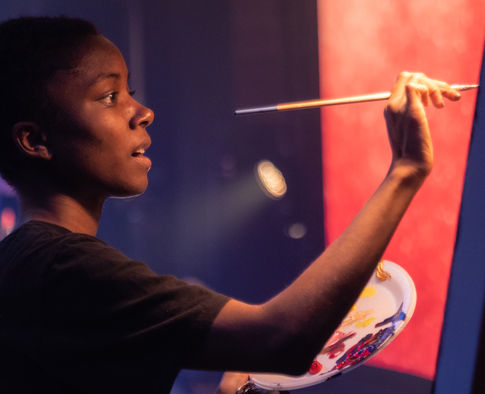 Ashley Henry Artist - Painting on Stage