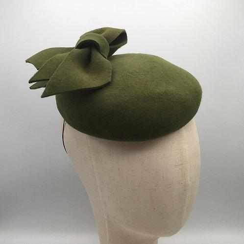 Sarah - Green felt headpiece on a button base with green felt bow
