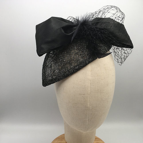 Kay - Black cocktail hat in black sinamay with a sparkle a black bow and feather