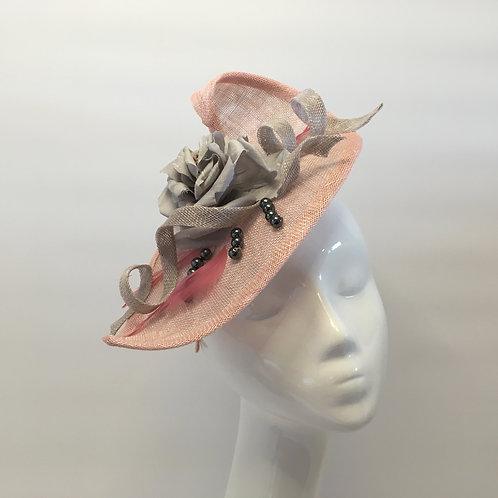 Storm -Pink sinamay straw headpiece on a headband
