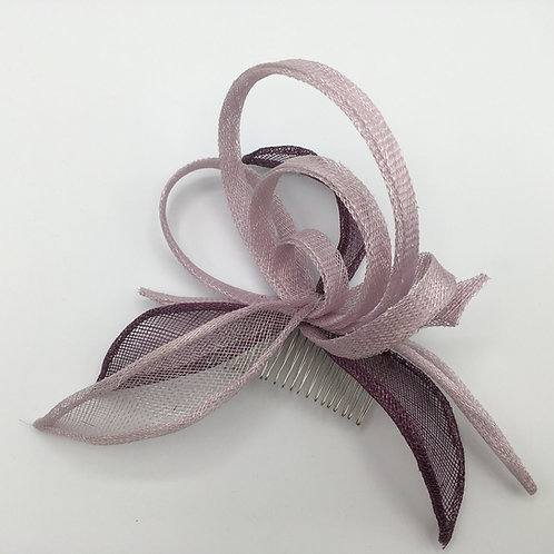 Belinda -Fascinator with purple and lilac sinamay circles and leaves on a comb
