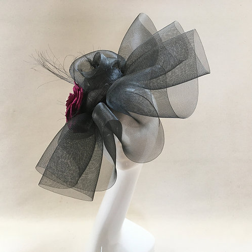 Valerie - Black crinoline headpiece with a sinamay base and camillia