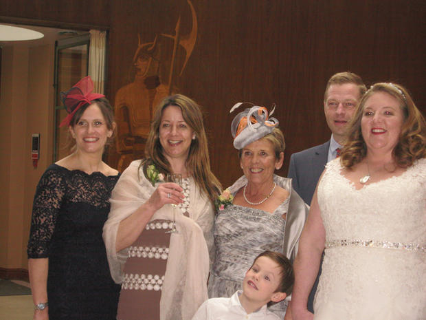 Red Fascinator and grey and orange button headpiece at Luy's wedding