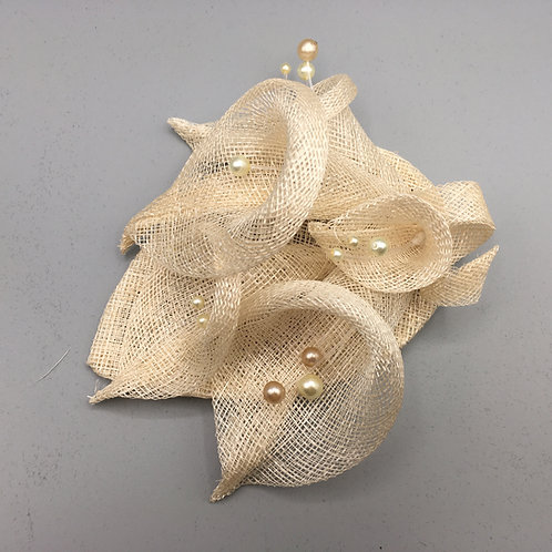 Eva - Fascinator with 5 cream sinamay lilies on a sinamay base with a comb