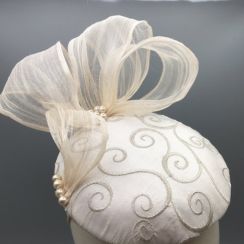 Marji - Cream embroidered silk button headpiece with silk abaca bow and pearls