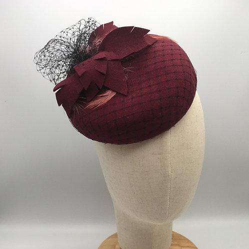 Edith - Burgundy wool felt button measuring with black veiling, felt andfeather