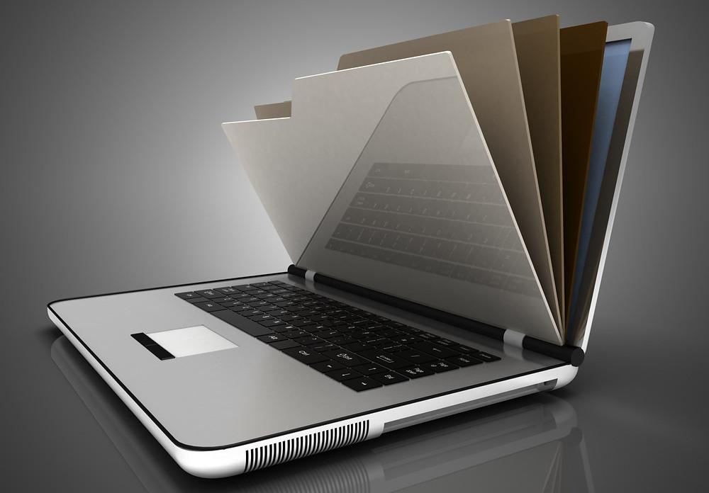 sistema para clínica de estética, imagem de um notebook com pastas de arquivo saindo da tela