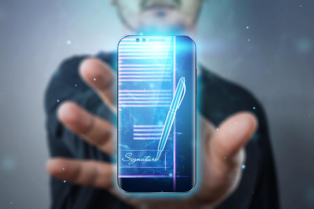 Assinatura Eletrônica, representação de um celular e caneta digital
