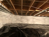 Properly encapsulated crawl space with 10 mil plastic vapor barrier and R-19 vinyl insulation.