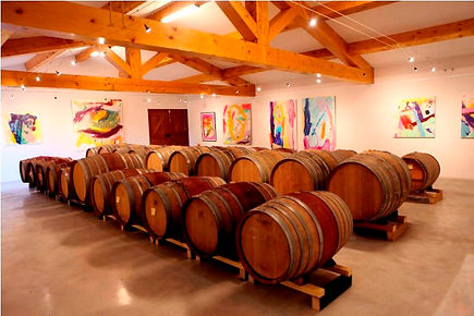 Inside Domaine de Tara Winery. A shot of the exhibit and wine barrels.