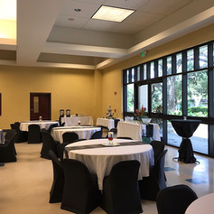 Event hall with views of full-service kitchen and patio