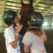 2 girls kissing horse.jpg