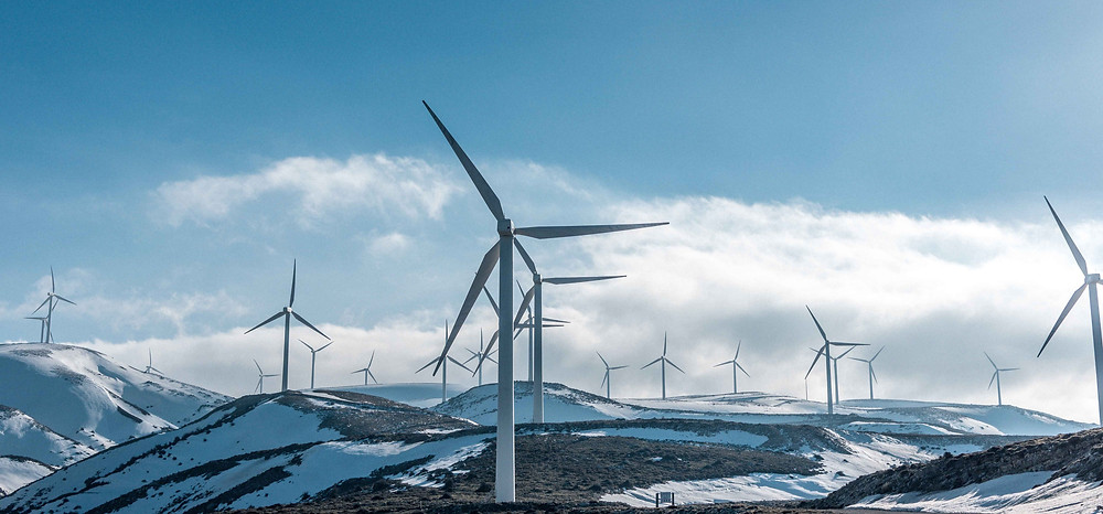Wind turbines in frozen landscape. The recent blackouts in Texas illustrates the true value of grid resilience as we transition to renewable energy system