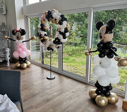 mickey minnie balloon sculture gold and