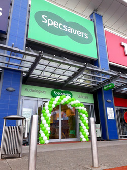 twisted balloon arch specsavers manchest