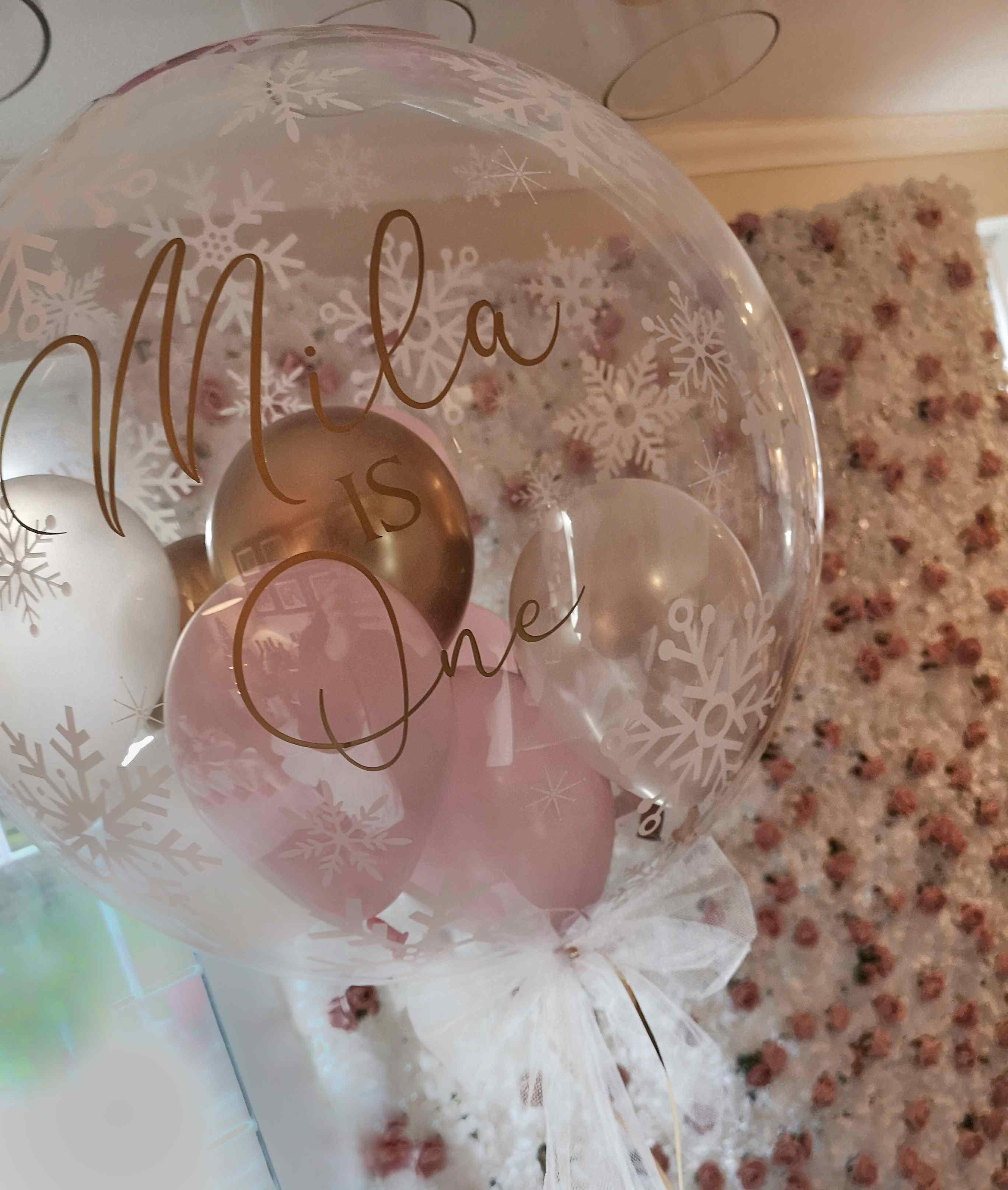 first birthday bubble balloon and flower