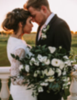 A Bride and Groom embracing each other on their wedding day.