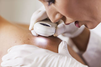 dermatologist-examining-patient-for-sign