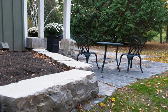 A stone wall & patio
